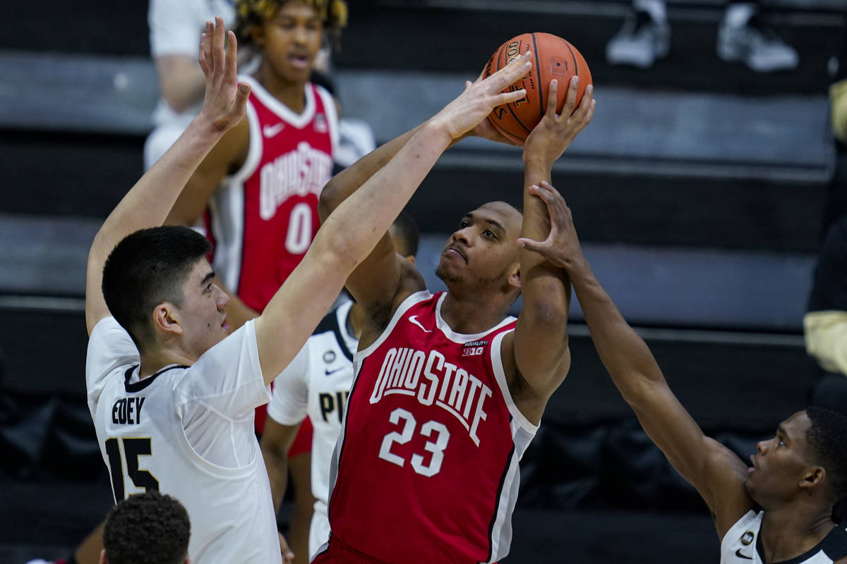 Ohio State forward Zed Key (23) shoots over Purdue center Zach Edey (15) in the first half of a ...