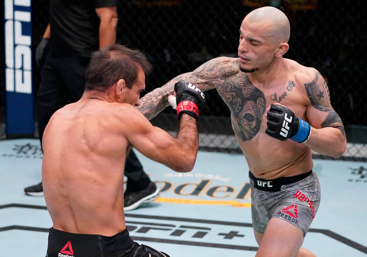 Ray Rodriguez punches Rani Yahya of Brazil in a bantamweight fight during the UFC Fight Night e ...