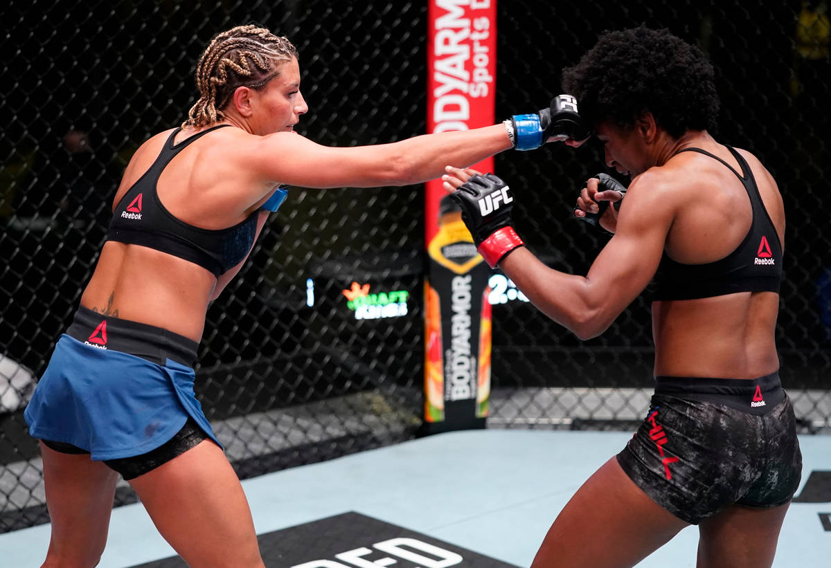 Ashley Yoder punches Angela Hill in a strawweight fight during the UFC Fight Night event at UFC ...