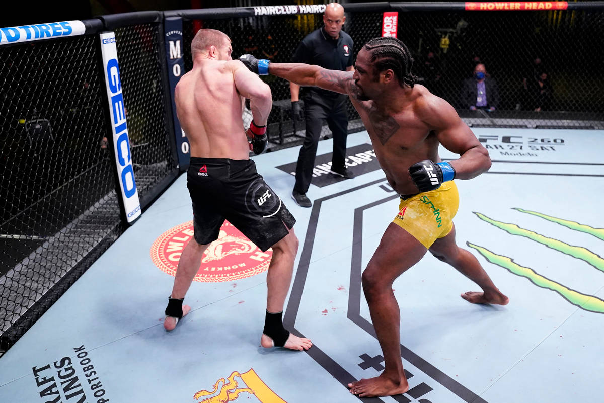 Ryan Spann punches Misha Cirkunov of Latvia in a light heavyweight fight during the UFC Fight N ...