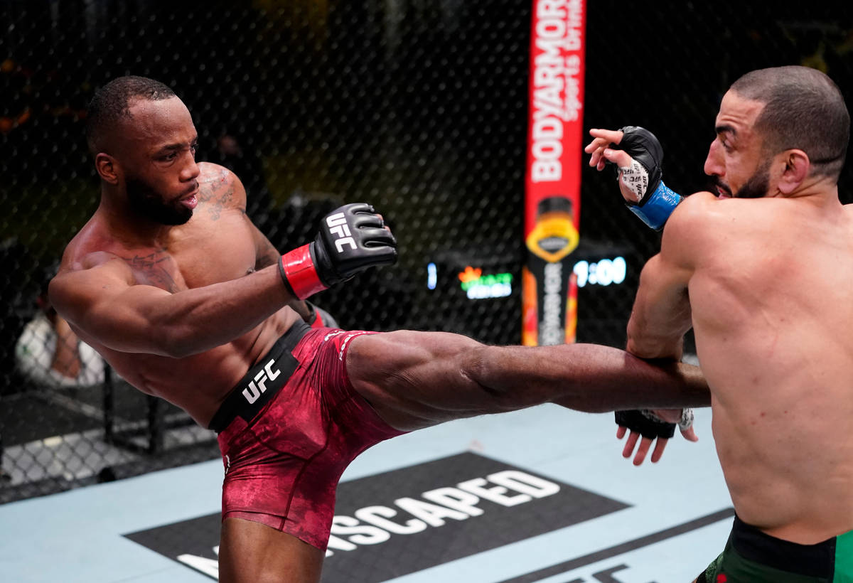 Leon Edwards of Jamaica kicks Bulal Muhammad in a welterweight fight during the UFC Fight Night ...