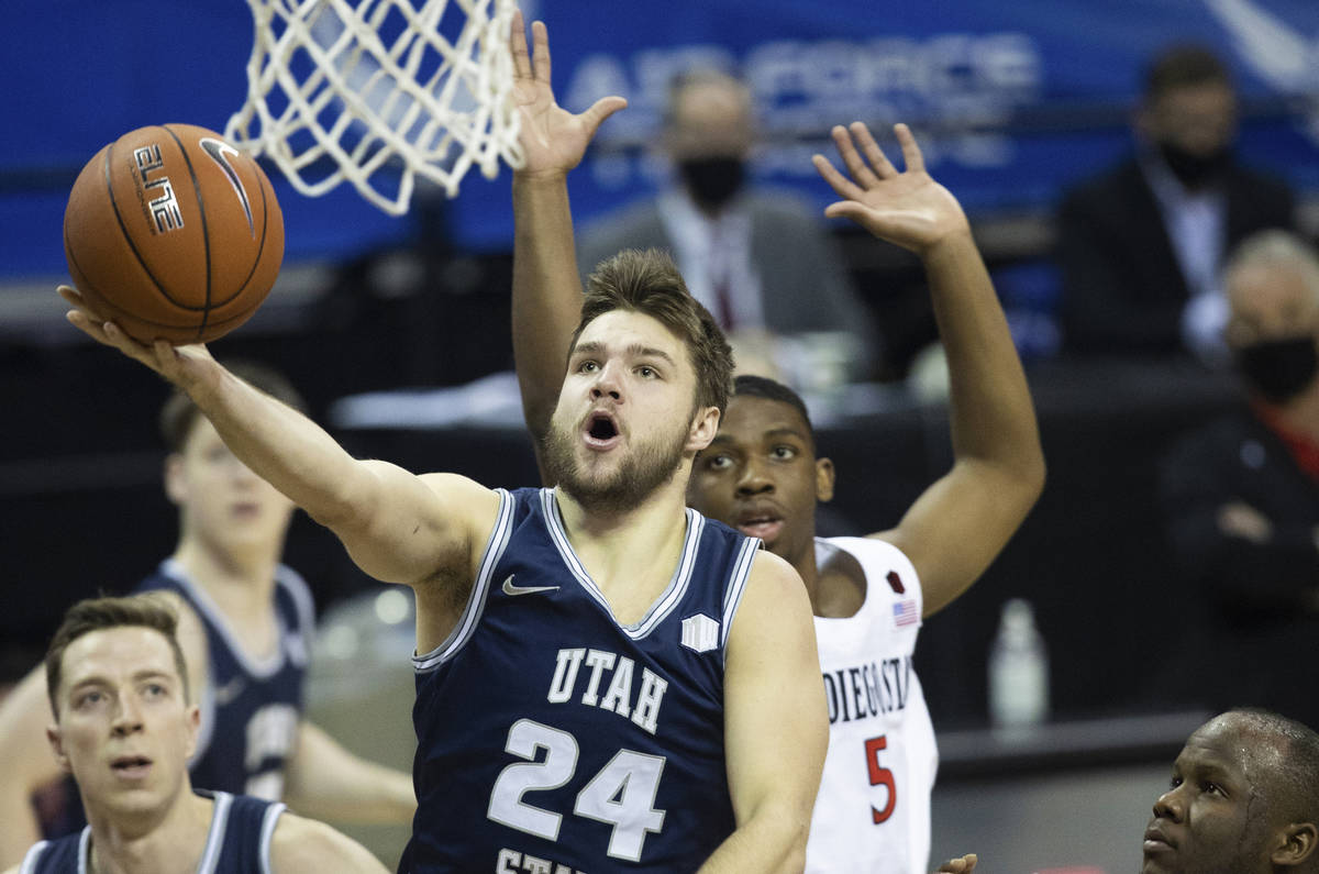 Utah State Aggies guard Rollie Worster (24) slashes to the rim past San Diego State Aztecs guar ...