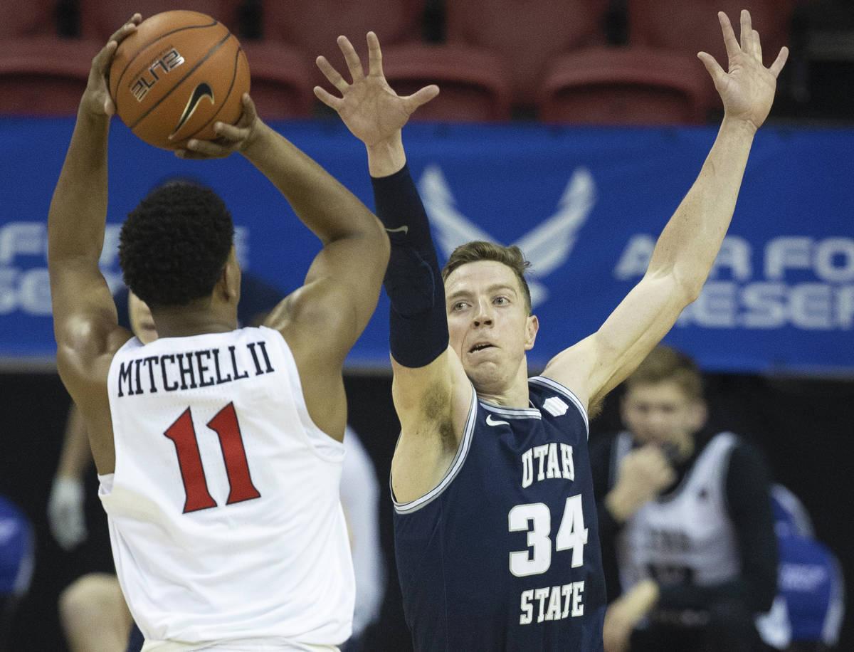Utah State Aggies forward Justin Bean (34) contests the shot of San Diego State Aztecs forward ...