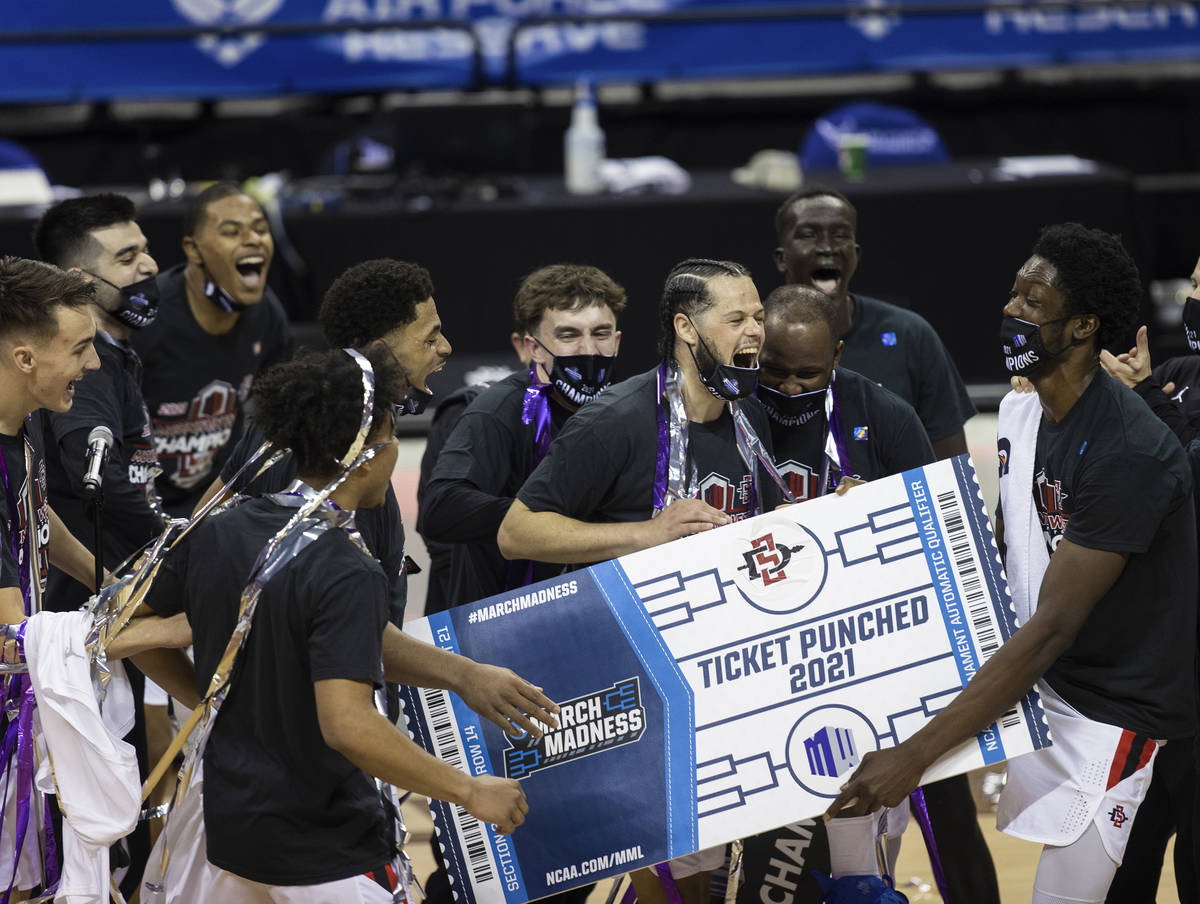 San Diego State Aztec players celebrates after winning the Mountain West conference men's colle ...