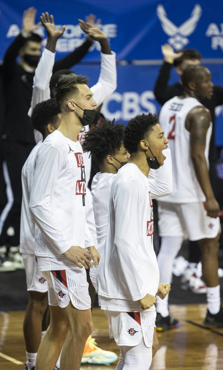 San Diego State Aztec players celebrate a big play in the second half during the Mountain West ...