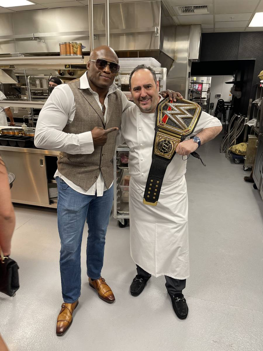 WWE champ Barry Ashley (left) is shown with Chef Barry Dakake at Barry's Downtown Prime on Frid ...