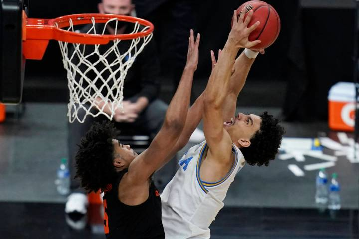 Oregon State's Ethan Thompson, left, fouls UCLA's Jules Bernard during the second half of an NC ...