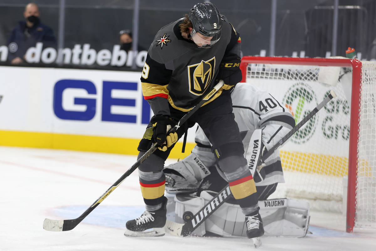 Vegas Golden Knights Cody Glass (9) fights for the puck against Los Angeles Kings goaltender Ca ...