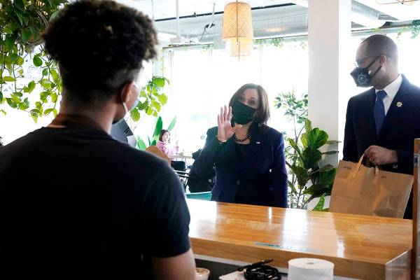 Vice President Kamala Harris, right, talks to employees while stopping for lunch at Tacotarian, ...