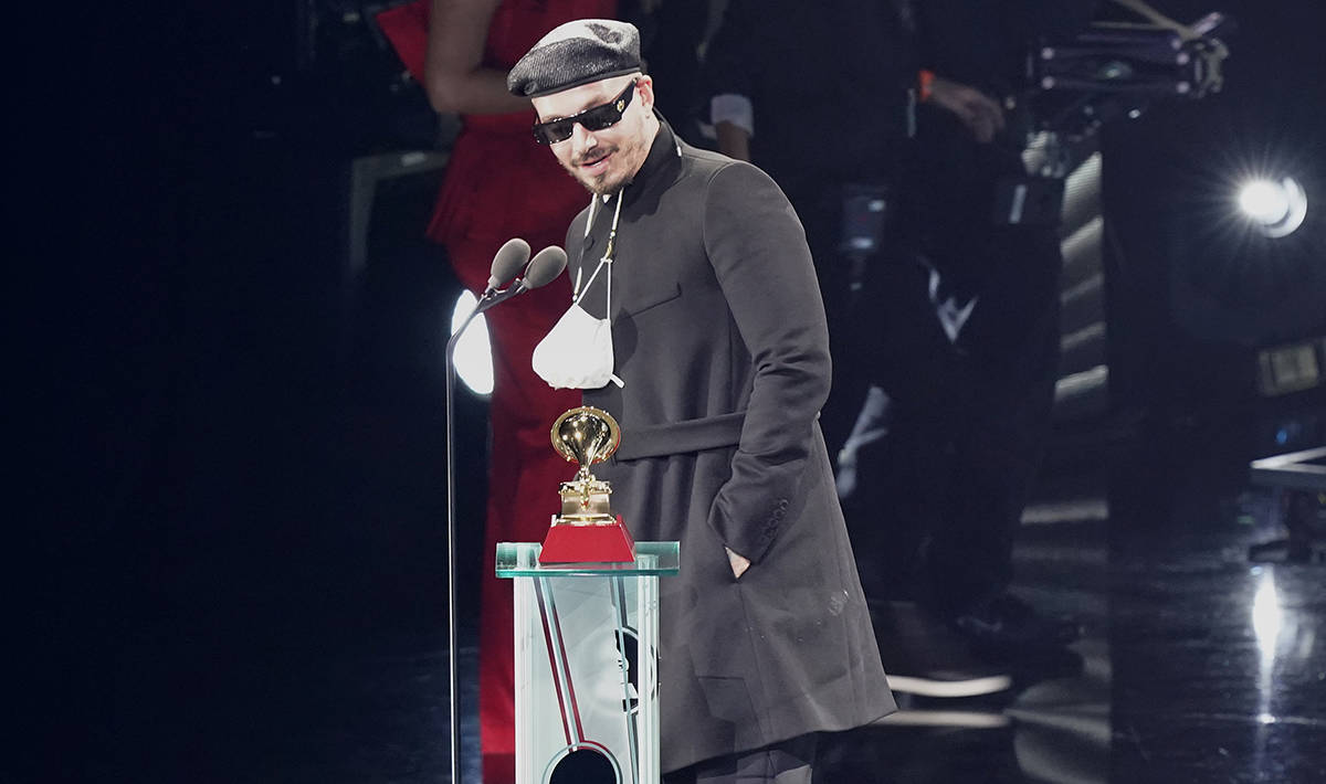 """J Balvin accepts the award for the best urban music album for """"Colores"""" at the 21st edition of ..."""