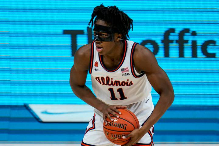 Illinois guard Ayo Dosunmu (11) plays against Ohio State during the second half of an NCAA coll ...