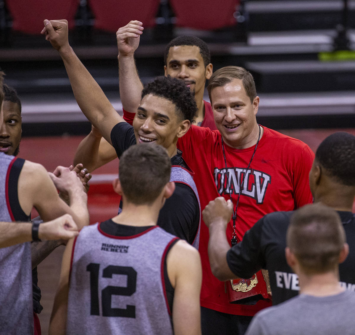 UNLV basketball head coach T. J. Otzelberger comes together with his players ending practice in ...