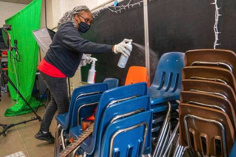 In this Thursday, March 4, 2021, file photo, Latisha Bledsoe cleans chairs in the music room at ...