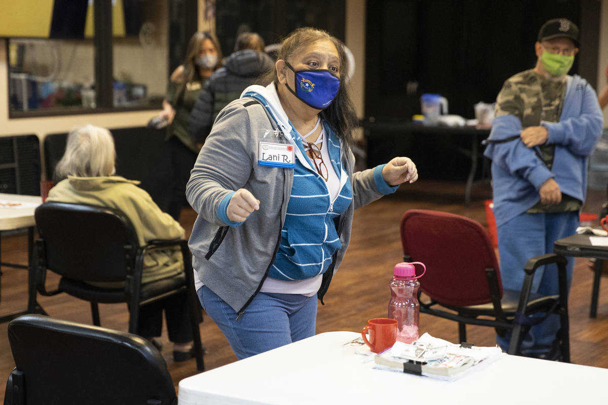 Lani Reardon, 61, dances to the music during a physical activity at Nevada Adult Daycare Health ...
