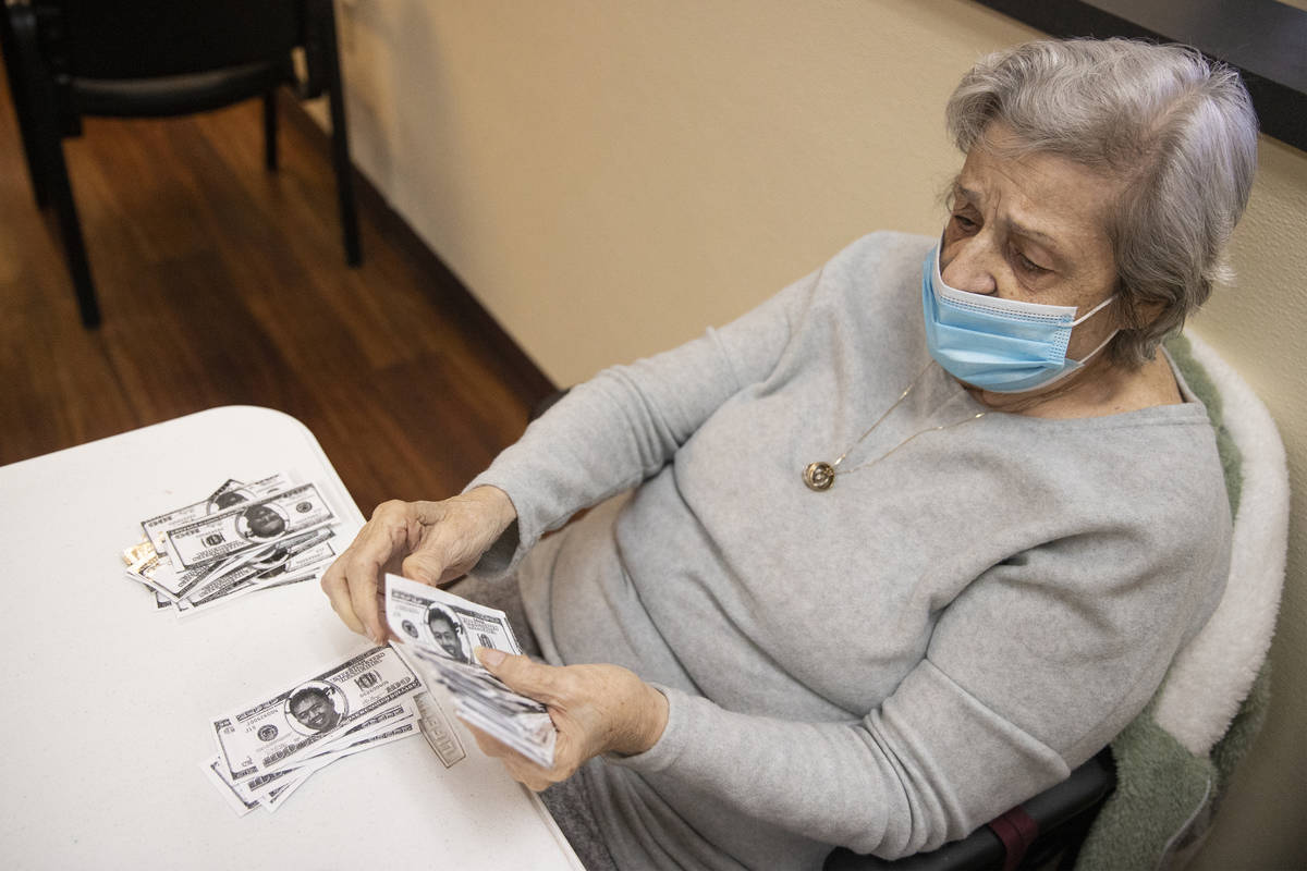 Grace Fagone, 83, counts bingo money at the Nevada Adult Daycare Health Center in Las Vegas, on ...