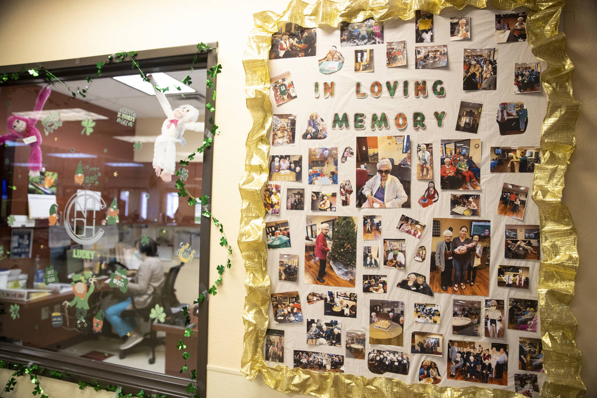 Pictures on a wall remember a former member of the Nevada Adult Daycare Health Center in Las Ve ...