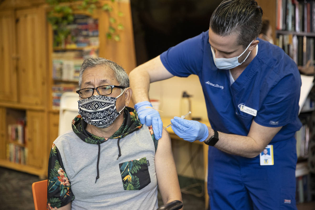 Leonardo Terravova, 66, receives the COVID-19 vaccine from Touro University Nevada physician as ...