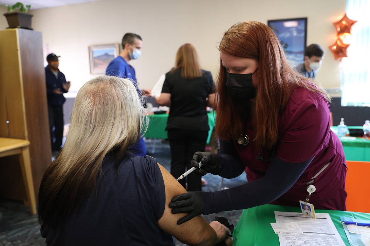 Touro University Nevada physician assistant student Brianne Gustafson, right administers the CO ...