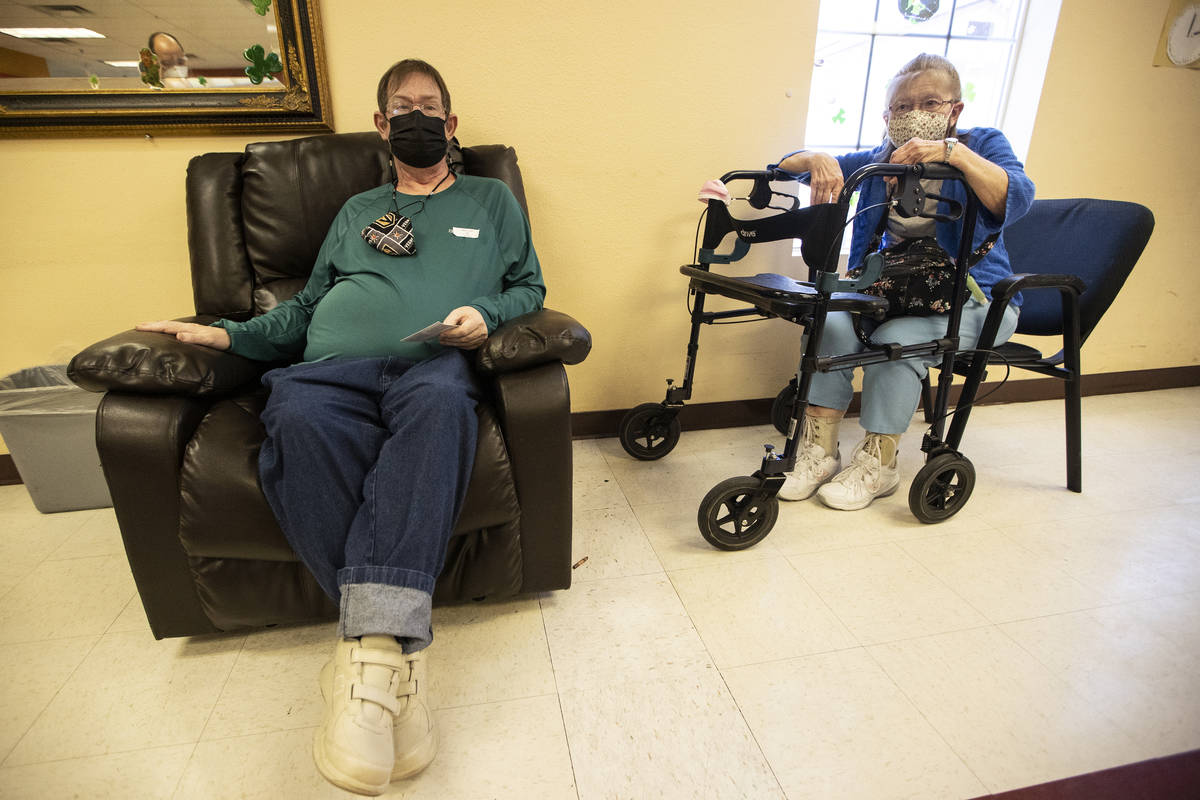 Cheryl Ray, 72, right, waits with her son Michael, 47, after he received the second dose of the ...