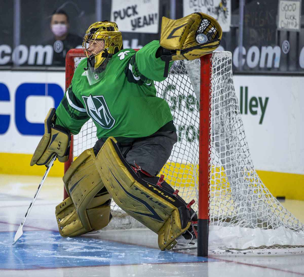 Golden Knights goaltender Marc-Andre Fleury (29) makes a stop during the warm ups before an NHL ...