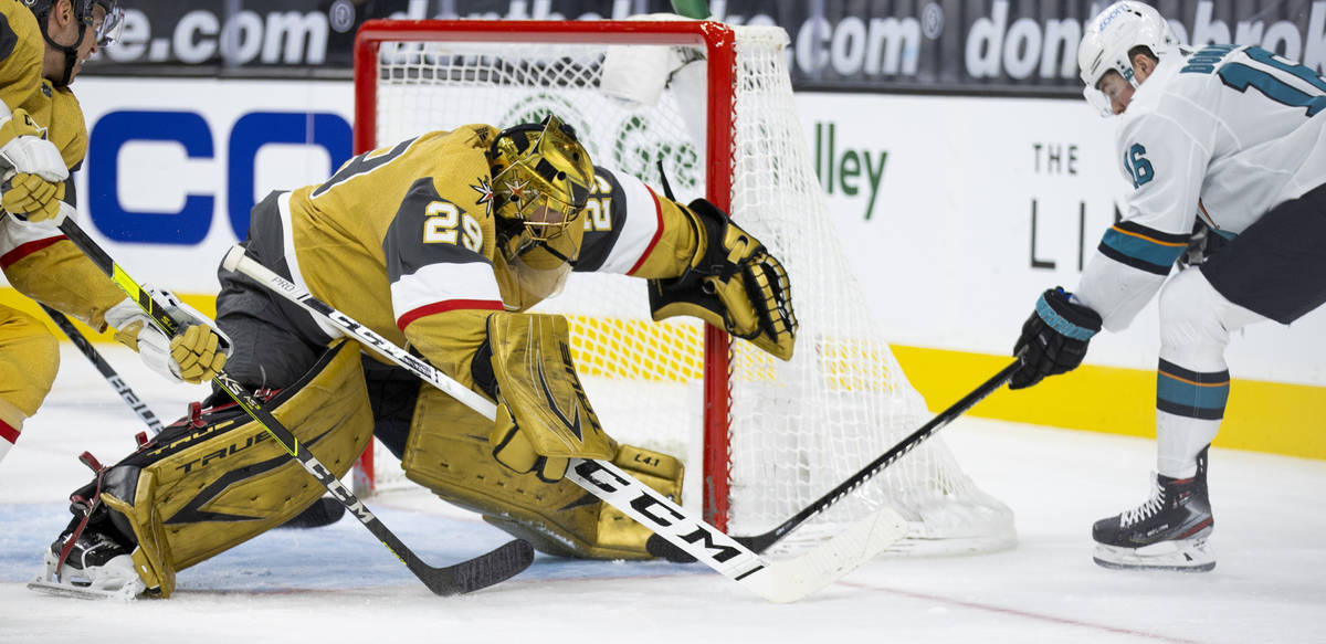Golden Knights goaltender Marc-Andre Fleury (29) gets a skate on the puck shot on goal by San J ...
