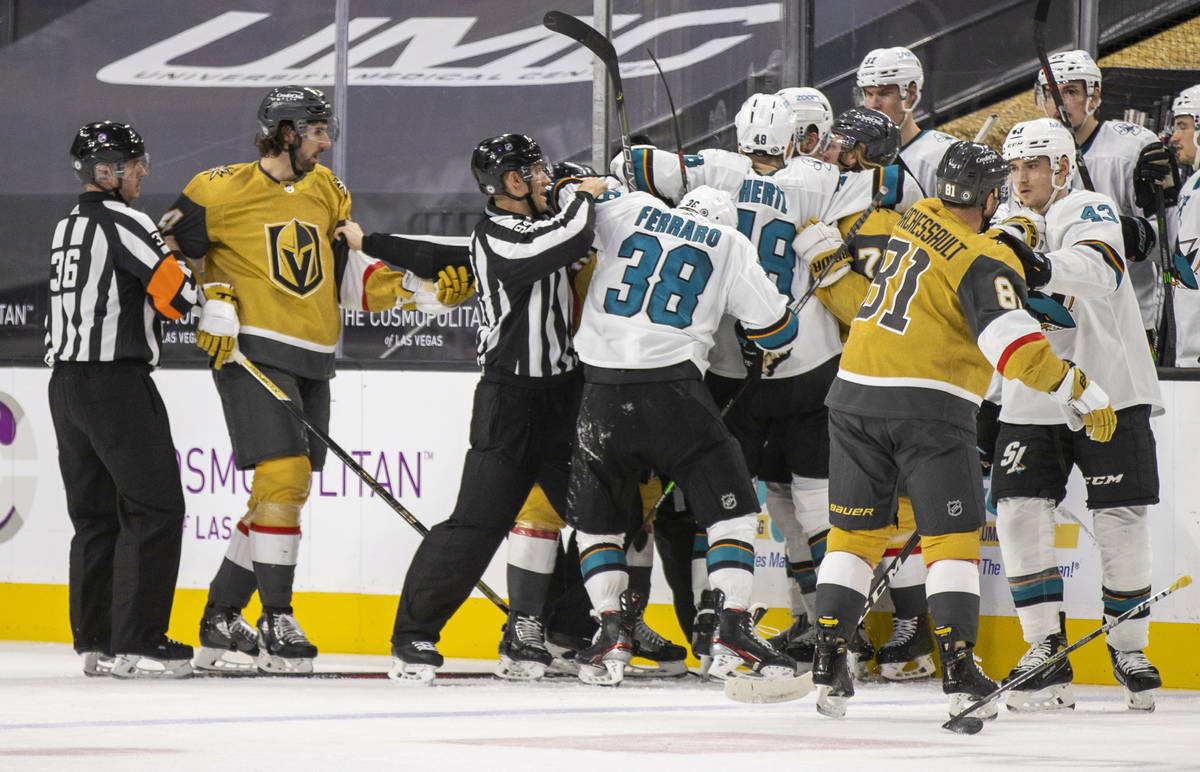 Golden Knights and San Jose Sharks players fight during the second period of an NHL game at T-M ...