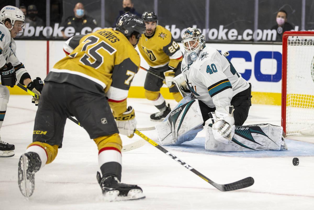 San Jose Sharks goaltender Devan Dubnyk (40) looks to s hot by Golden Knights right wing Ryan R ...