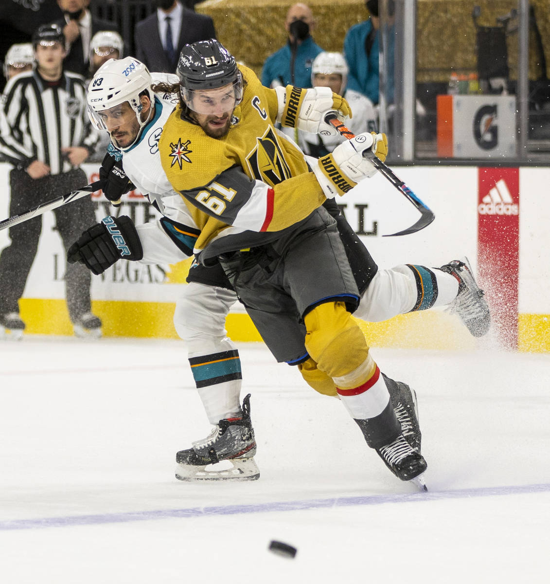 Golden Knights right wing Mark Stone (61) sends a shot to the goal over San Jose Sharks left wi ...