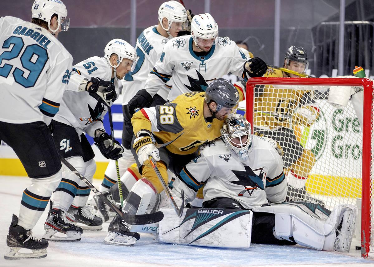 Golden Knights left wing William Carrier (28) gets over the top of San Jose Sharks goaltender D ...
