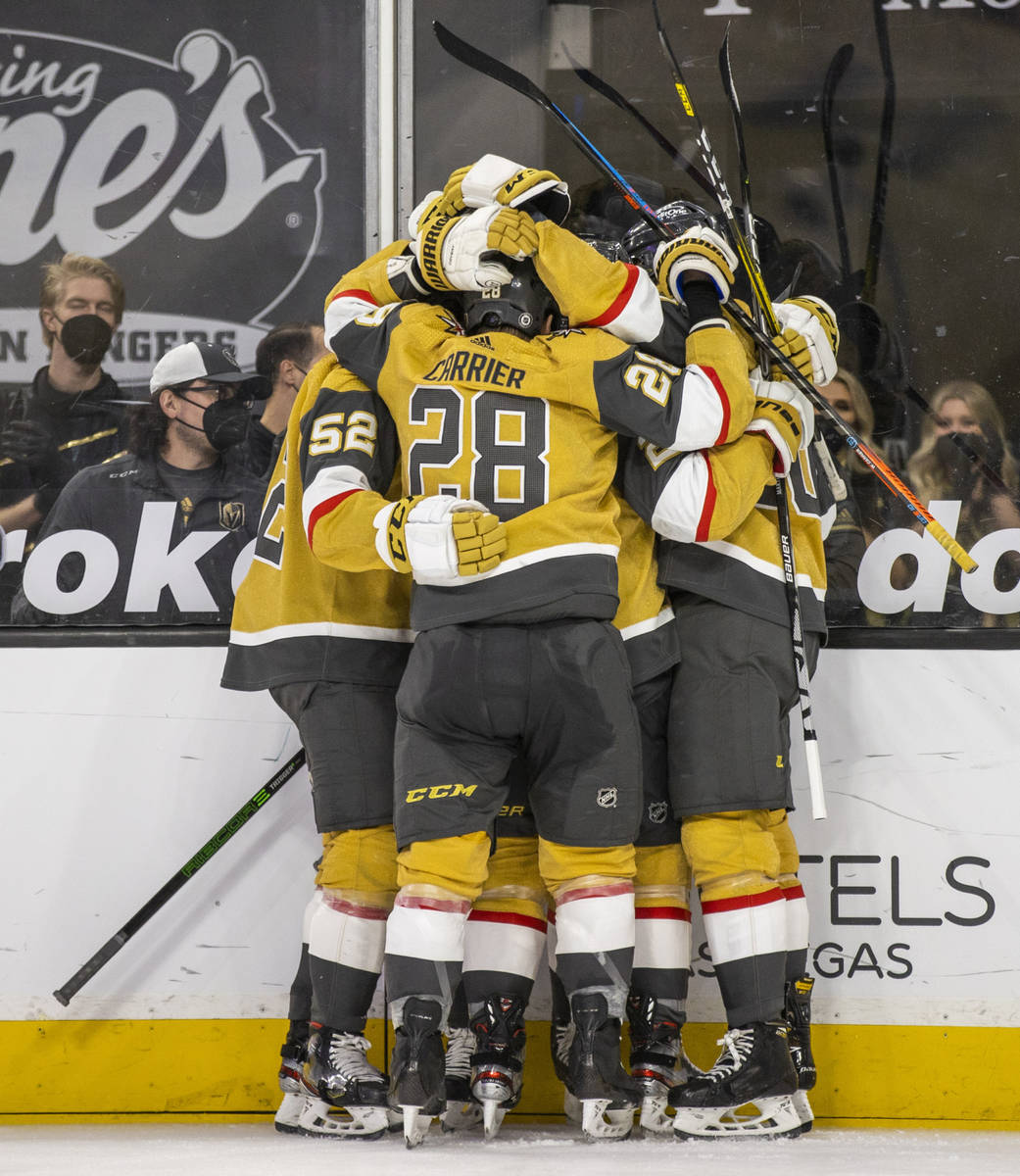 Golden Knights players celebrate a possible goal over San Jose Sharks goaltender Devan Dubnyk ( ...