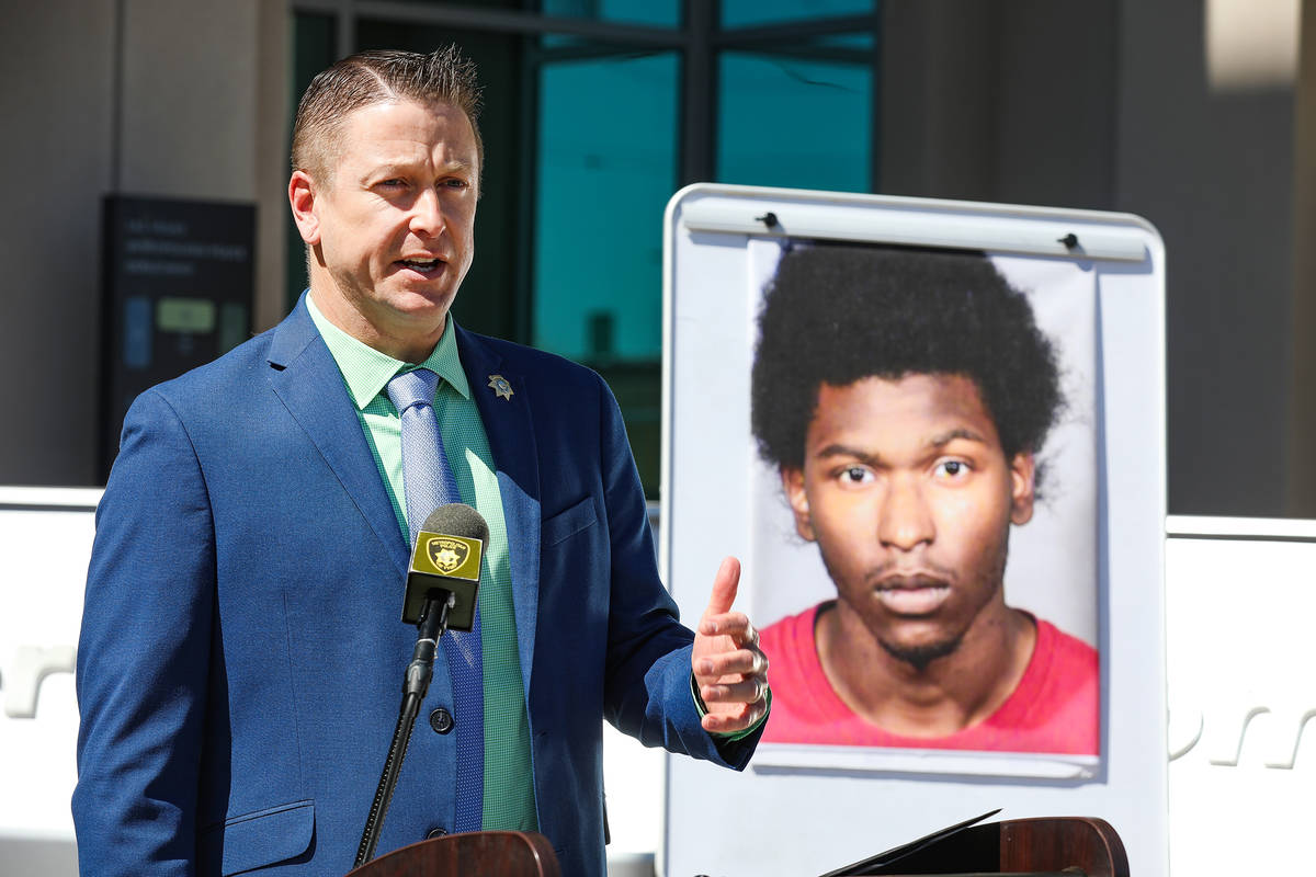 Sex Crimes Lieutenant Richard Meyers addresses the media next to a photo of Laparese Jones, the ...