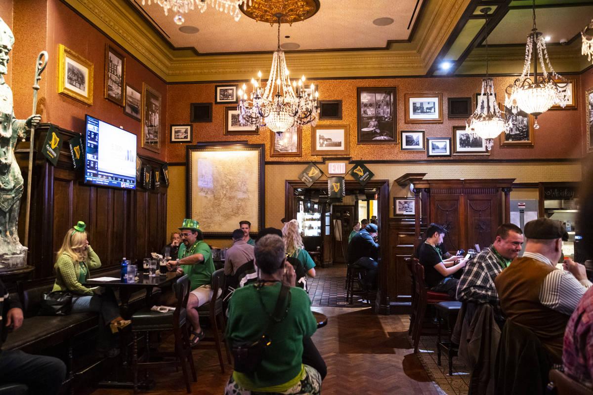 People gather to celebrate St. Patrick's Day at Ri Ra Irish Pub at the Shoppes at Mandalay Plac ...