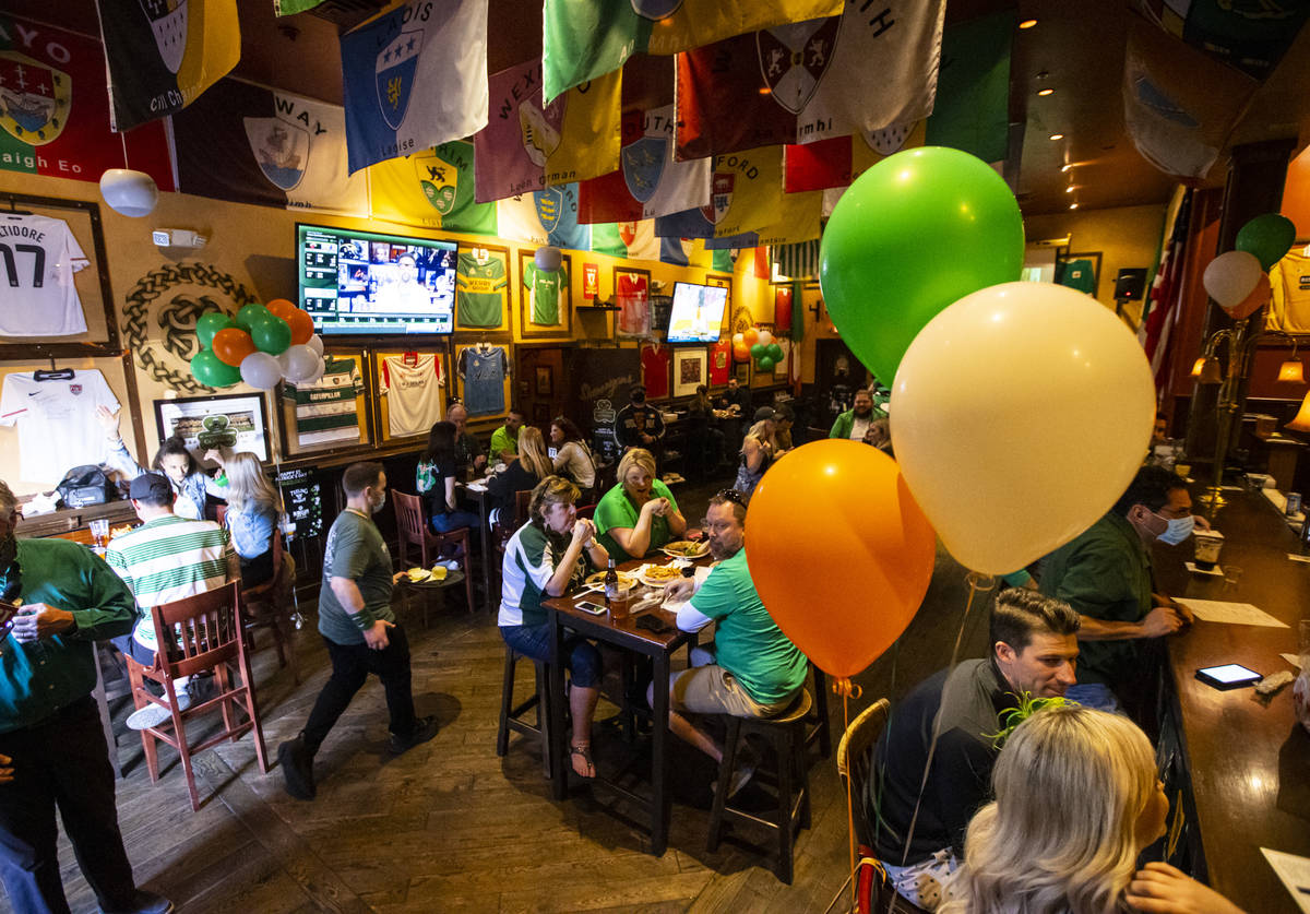 People gather to celebrate St. Patrick's Day at McMullan's Irish Pub in Las Vegas on Wednesday, ...