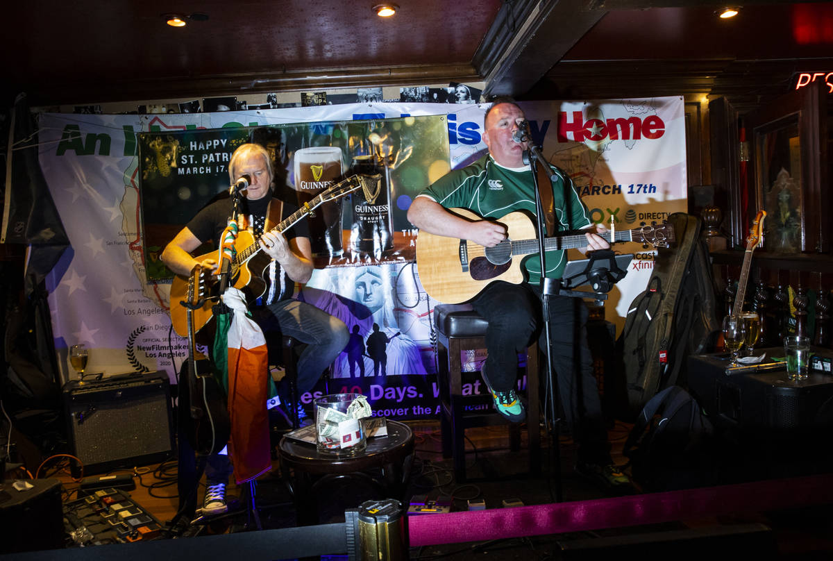 David Browne, left, and Dave Rooney, of The Black Donnellys, perform as people gather to celebr ...