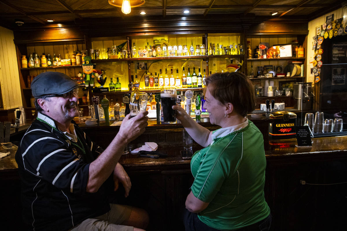 Arthur McFarland, left, and Kim McFarland toast as people gather to celebrate St. Patrick's Day ...