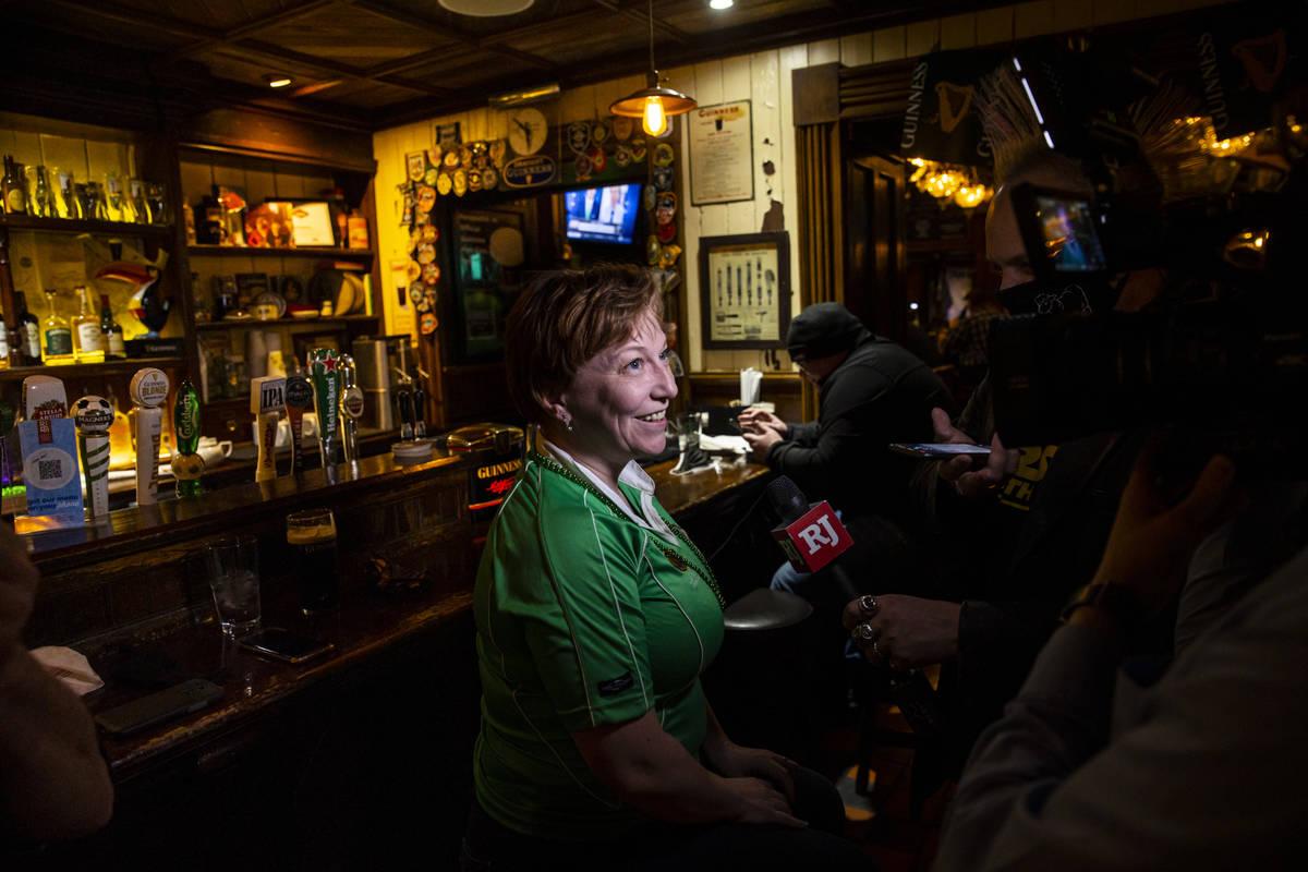 Kim McFarland, of Las Vegas, speaks about visiting Ri Ra Irish Pub as people gather to celebrat ...