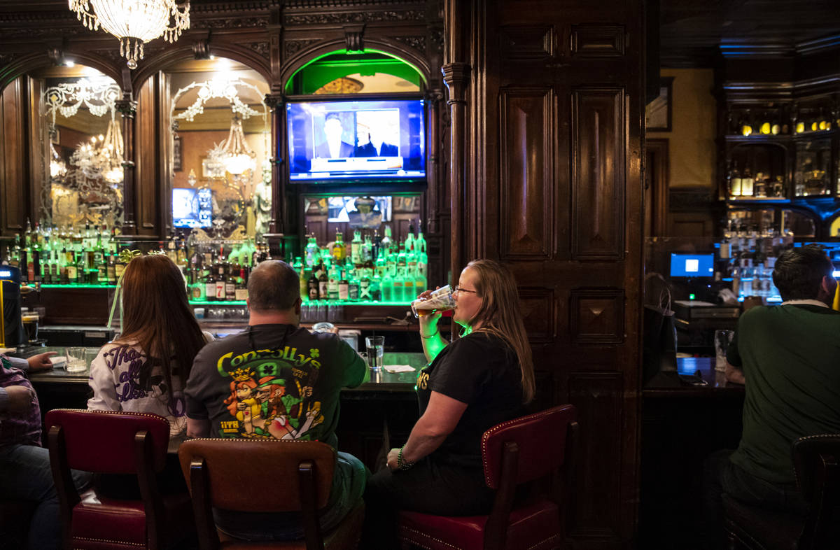 Regina Gordon, Phoenix, drinks by the bar as people gather to celebrate St. Patrick's Day at Ri ...