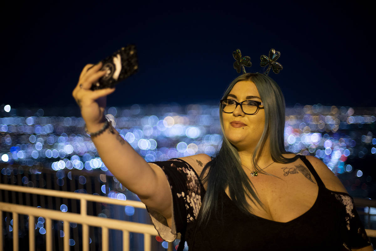 Alexa Herrera, of Las Vegas, takes a selfie on St. Patrick's Day, and her birthday, at The STRA ...