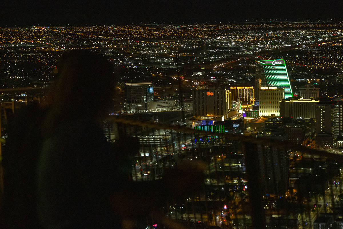 Visitors to The STRAT view the Las Vegas Valley, including Circa which is lit green for St. Pat ...