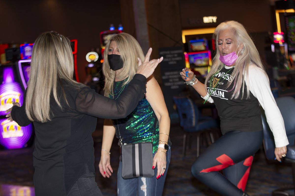 Christine Cowser, left, Debbie Andrews and Susie Swiercz dance to The Celtic Rockers play at RE ...
