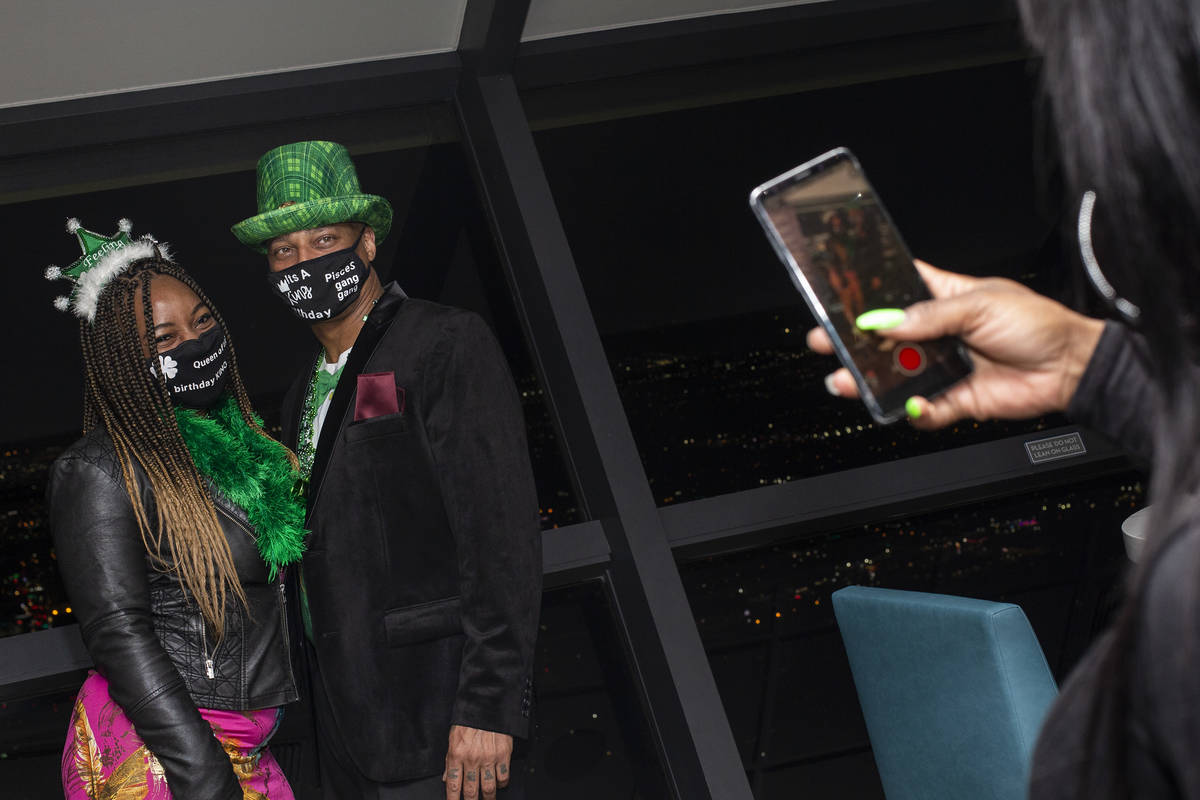 Asia Harris photographs Ashley Brittain, left, and Rob Robinson, all of New Jersey, on St. Patr ...