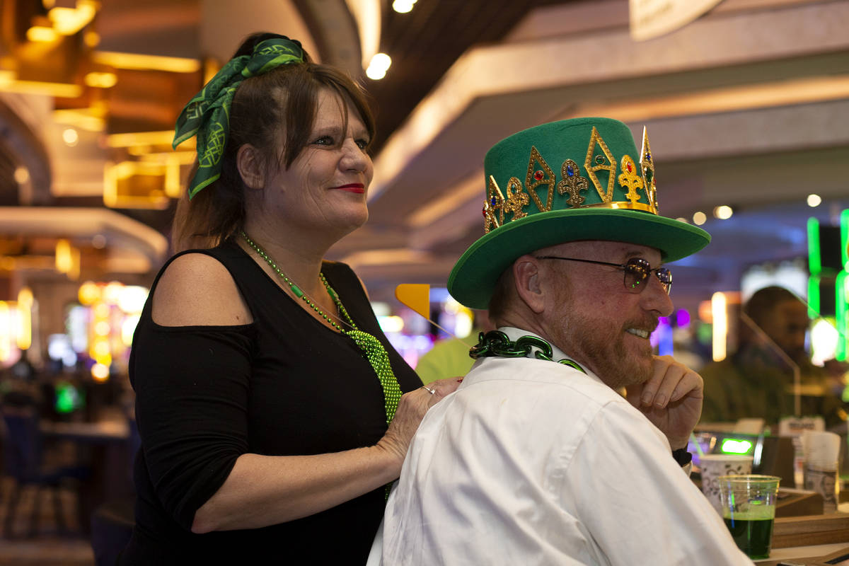 Christine O'Neil of Boston, left, and Jack Andrews of Baltimore listen to The Celtic Rockers pl ...