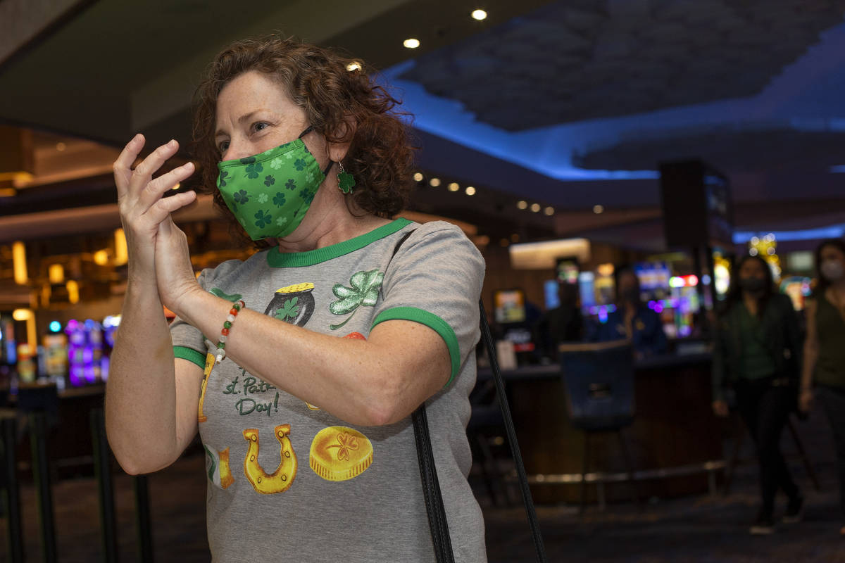 Las Vegan Vicki Toth claps along to The Celtic Rockers play a show on St. Patrick's Day at The ...