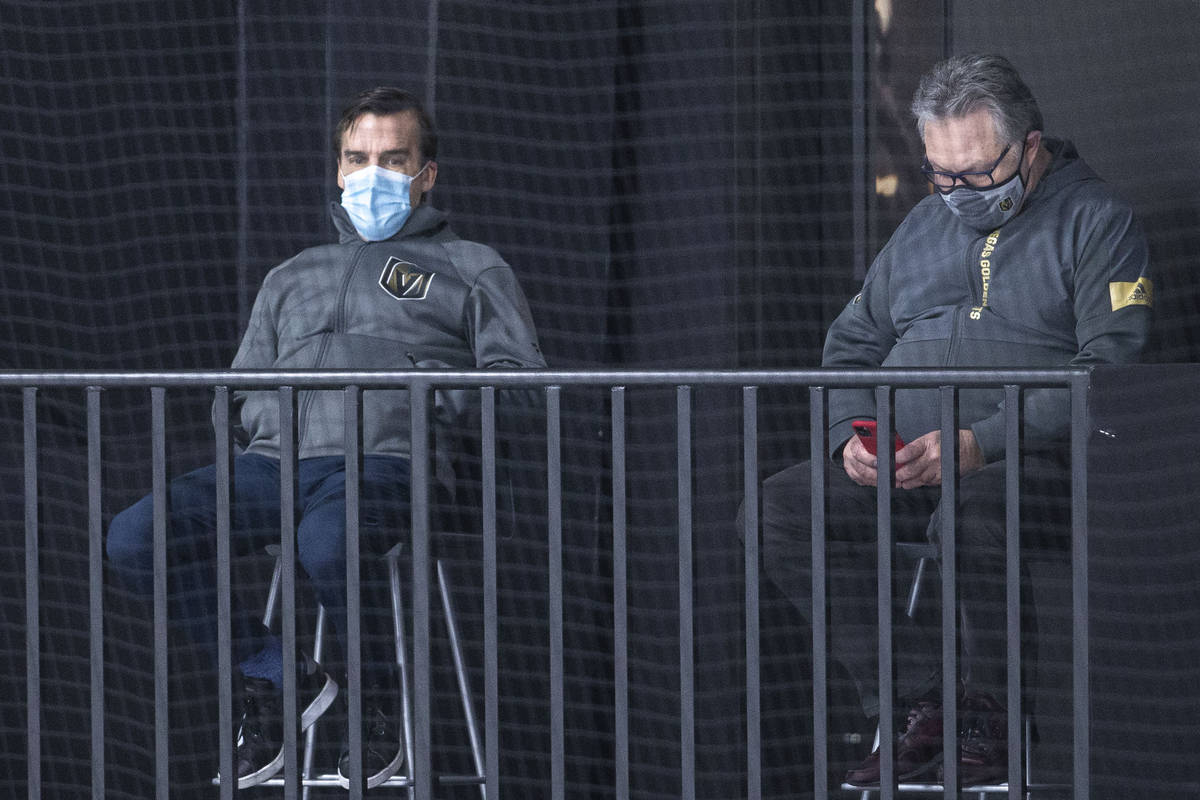 Golden Knights president of hockey operations George McPhee, left, and general manager Kelly Mc ...