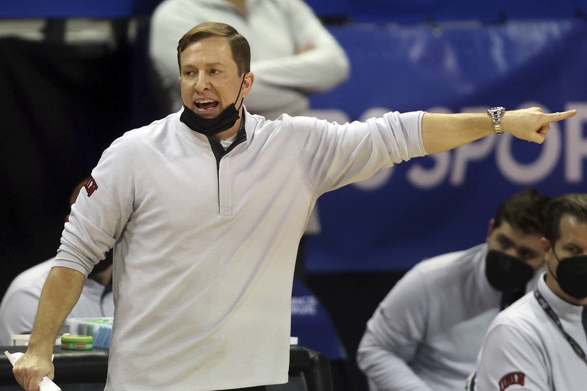 UNLV head coach T.J. Otzelberger instructs his team during the second half of an NCAA college b ...