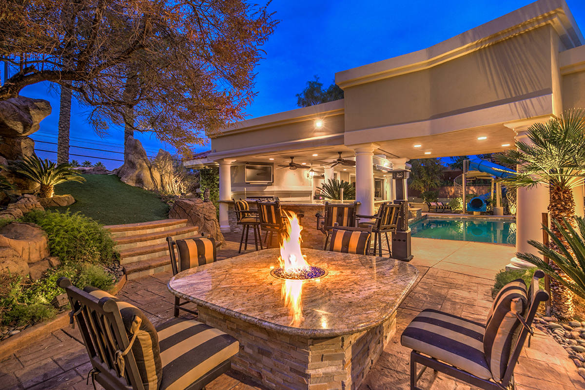 Patio has bar and fire pit table. (Mark Wiley Group)