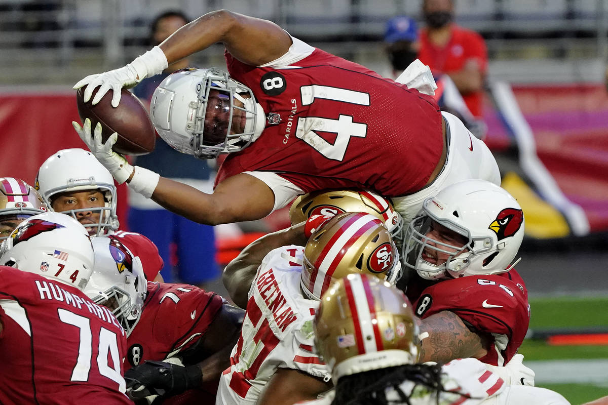FILE - Arizona Cardinals running back Kenyan Drake (41) dives over the line for a touchdown aga ...