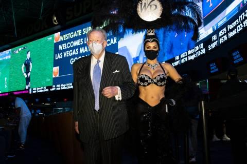 Former Las Vegas Mayor Oscar Goodman leaves Westgate Superbook with showgirl Jennifer Gagliano ...