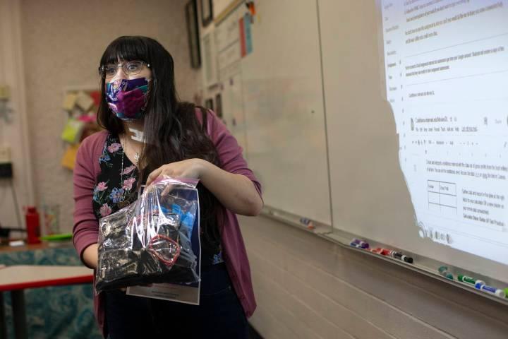 Lauren Engel, who teaches grades 9 through 12, explains what personal protective equipment is a ...