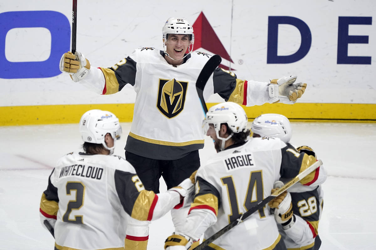 Vegas Golden Knights left wing Tomas Nosek, top, celebrates after assisting on a goal from Will ...